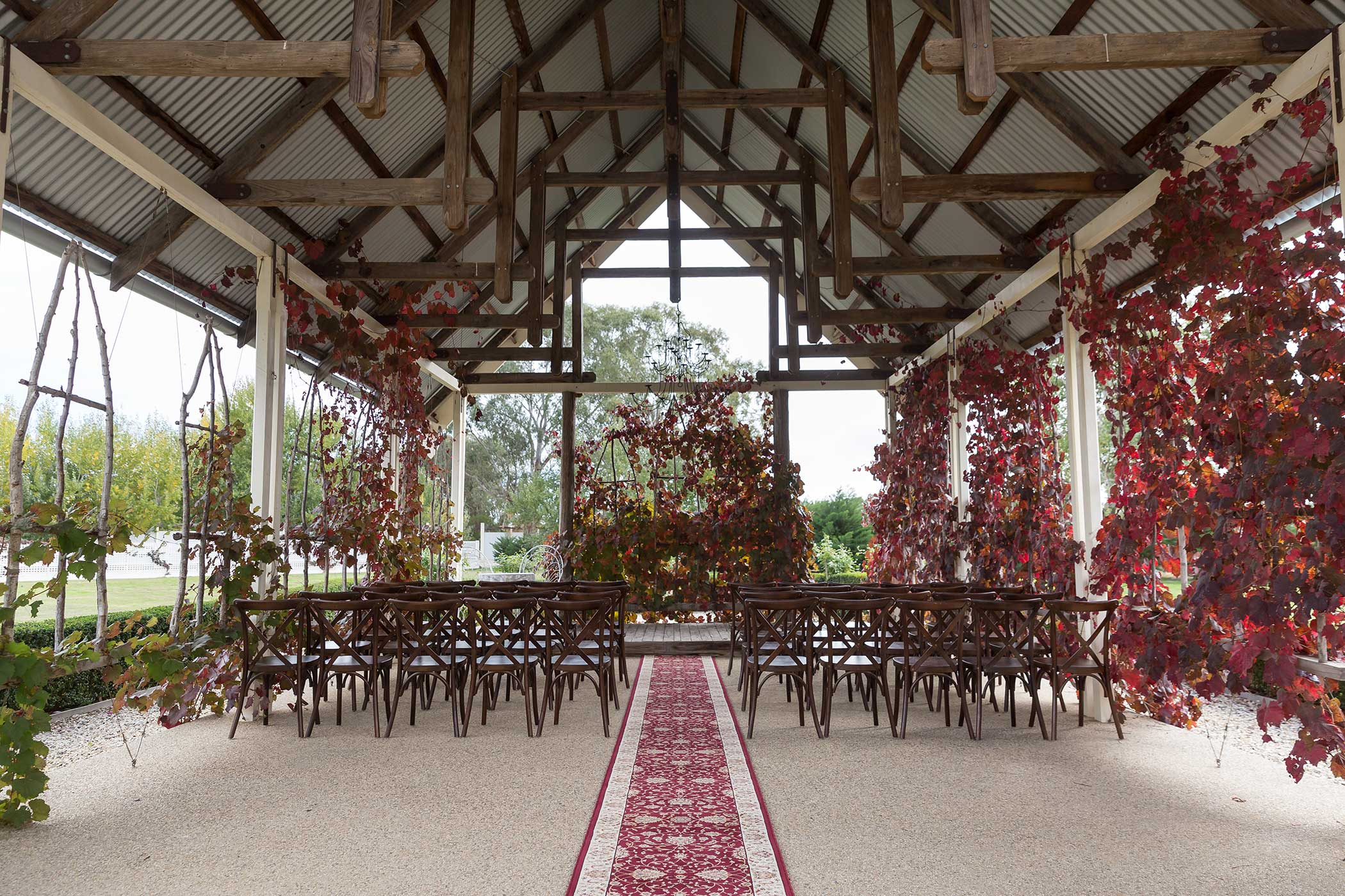 Outdoor chapel with autumn vines