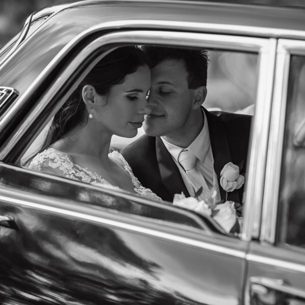Bride and Groom in Bridal Car