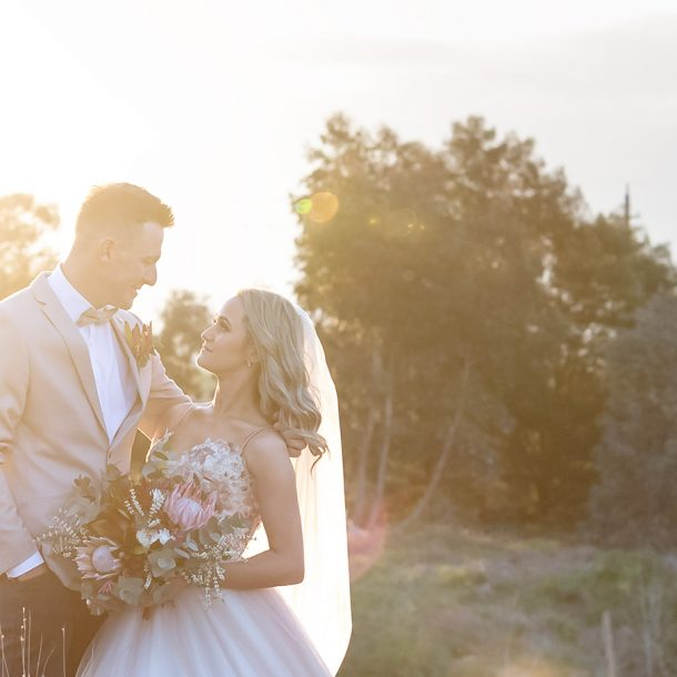 Bride and Groom in sunset light with Light-flare