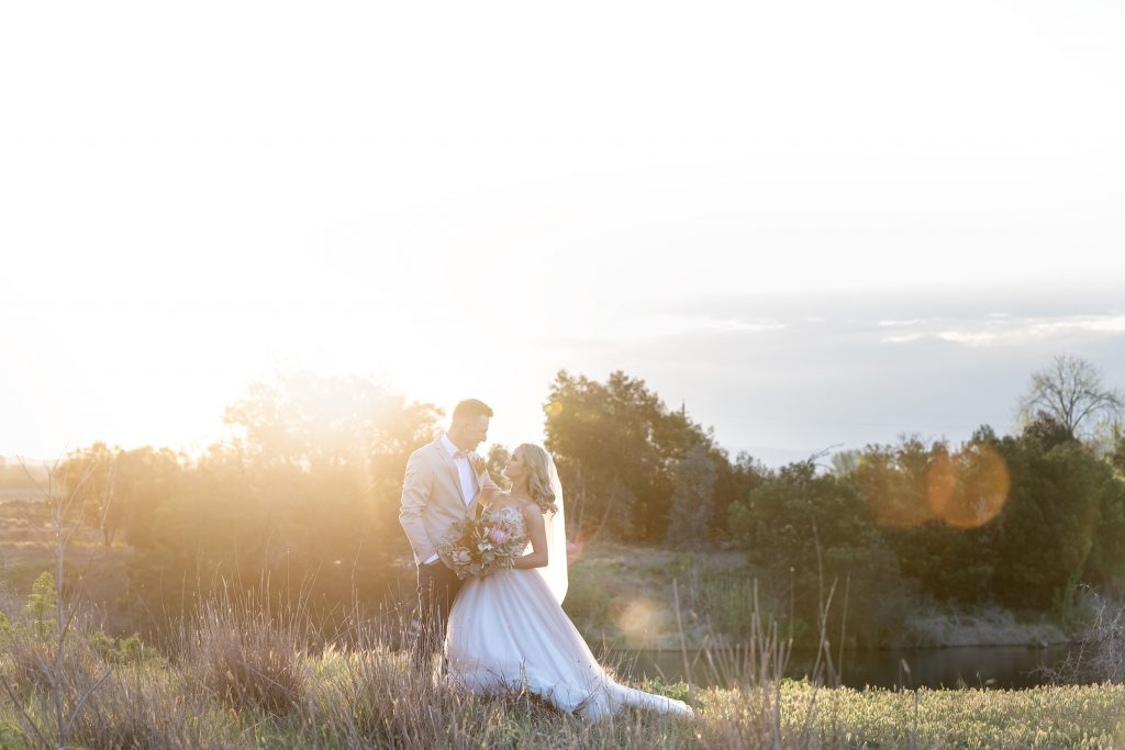 Bride and Groom at sunset natural setting