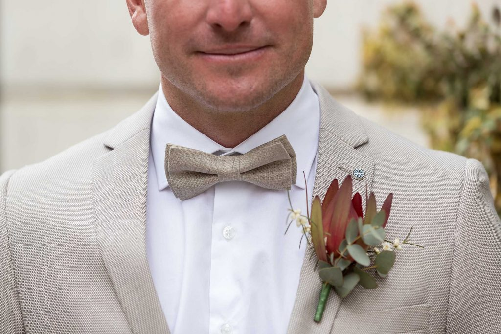 Details of Groom bow tie and flower