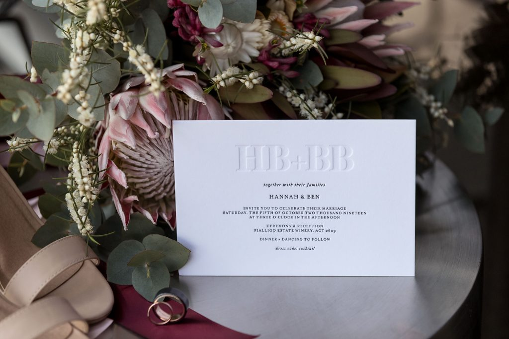Embossed Wedding Invitation, Bride Shoes and Native Wedding Flowers
