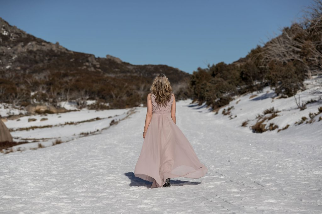 Model with gown in the snow