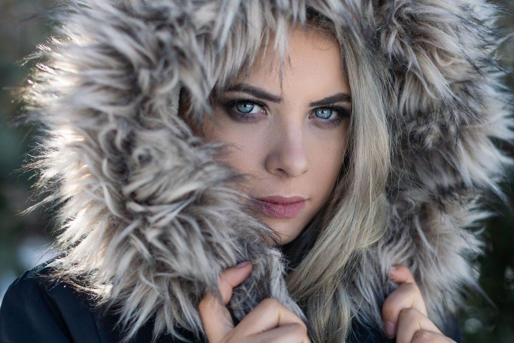 Portrait of Model with blue eyes wearing fur hood
