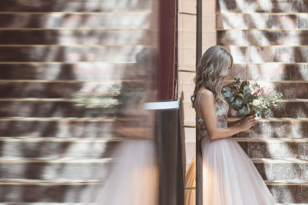 Reflection of Bride wearing two piece Gown with Native Wedding Flowers