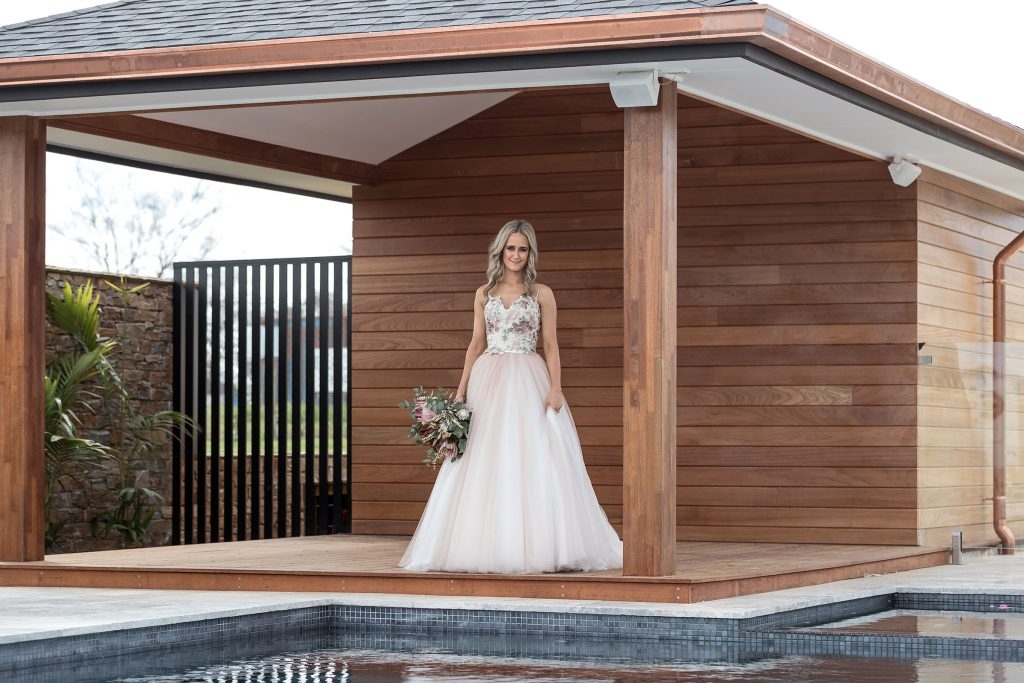 Bride wearing two piece Gown with Native Wedding Flowers