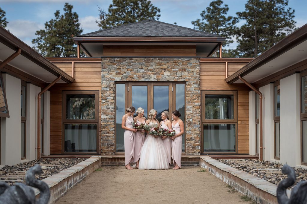 Bride and Bridesmaids pose in front of Feature Doorway