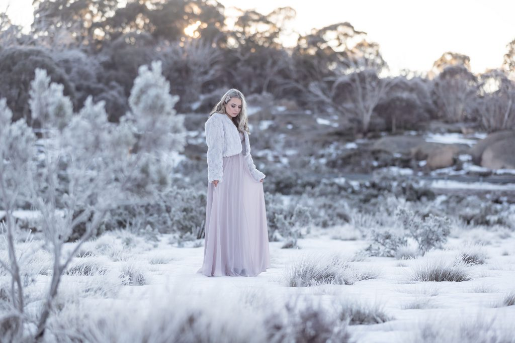 Model with gown in the snow and frost