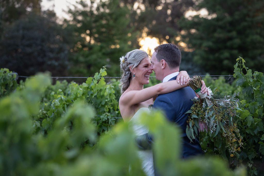 Bride and Groom in Vineyard at Brown Brothers Winery